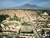 31 Oct 1991 --- Aerial view of the ruins of Pompeii with Mount Vesuvius on the horizon. Pompeii was destroyed by pyroclastic flows from the volcano in 79 A.D. --- Image by © Roger Ressmeyer/CORBIS